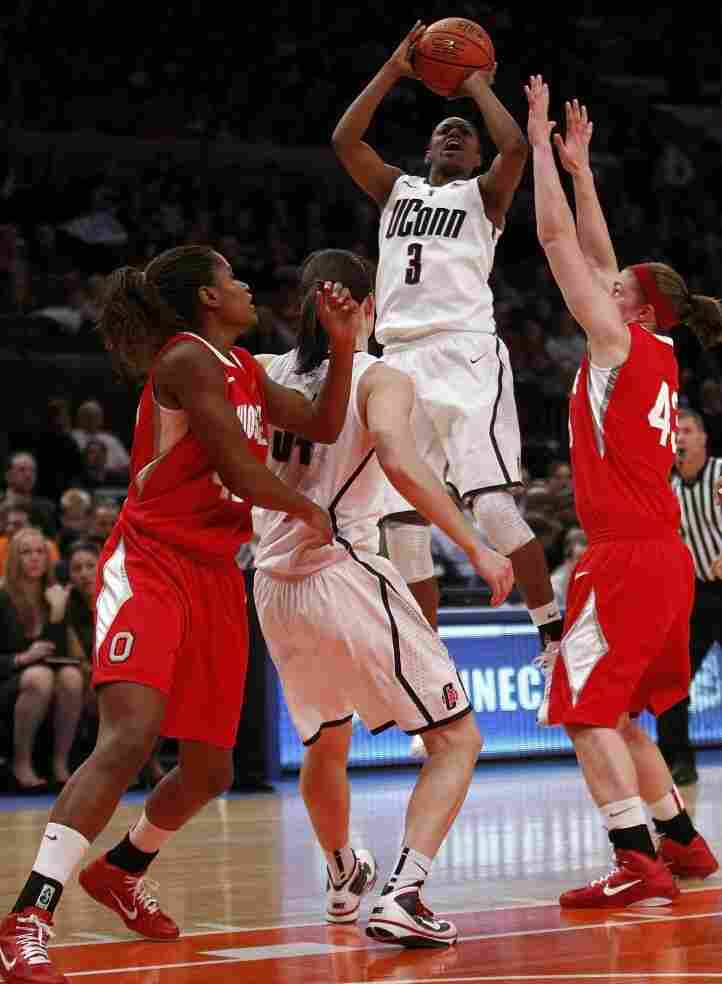 Tiffany Hayes (#3) of the Connecticut Huskies takes a jump shot against the Ohio State Buckeyes at Madison Square Garden on Dec. 19, 2010.