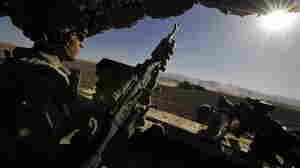 October 2009 file photo: U.S. Army Specialist Damyon Miller from the 3rd Platoon, Charlie Company, 1st Infantry Regiment, 5th Stryker Brigade Combat Team, 2nd Infantry Division, mans a machine gun mounted at the back of a Stryker vehicle as the large armored convoy patrols near the Afghanistan and Pakistan border.