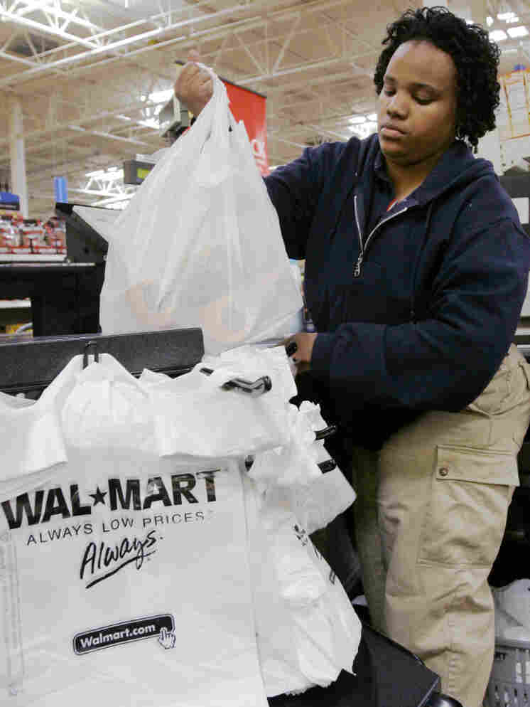 Cashier Shawntee Powell bags merchandise at Chicago's Walmart in 2007. Other big-box stores, including Target, also have big-city plans.