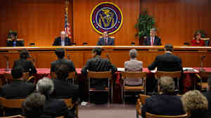 Federal Communications Commission commissioners listen to staff recommendations.