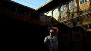An Afghan construction worker washes up before evening prayers in Kabul's Old City of Murad Khane.