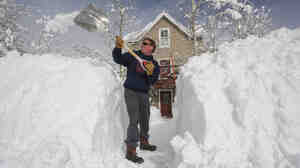Than Acuff of Crested Butte, Colo. shovels through a snowbank Wednesday.