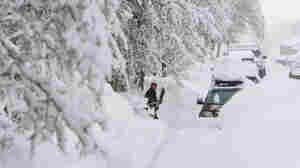 A person shovels snow in Crested Butte, Colo. on Dec. 21, 2010.