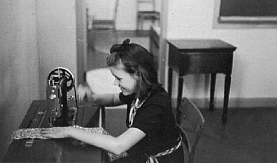 Girl sewing in home economics class, Greenhills, Ohio, 1938.
