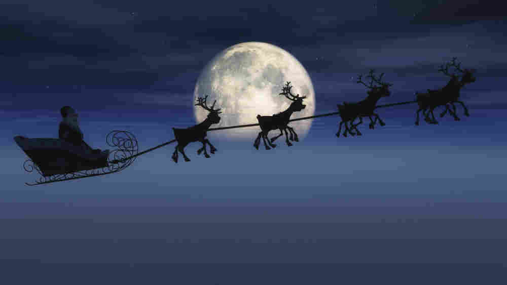 Santa's sleigh in front of the moon