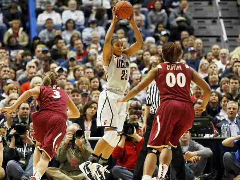 UConn's Maya Moore (23) looks to pass the ball against Florida State. Moore had a career-high 41 points and 10 rebounds as Connecticut set a record with 89 straight wins without a defeat.