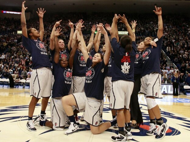 The Connecticut women's basketball team celebrates after their record-setting 89th straight win.
