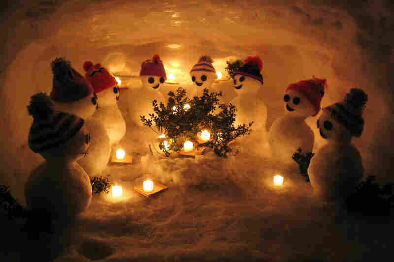 These 2-inch-tall snowmen celebrate Christmas on the Noto Peninsula in Japan. Japanese snowmen typically have two segments instead of three.