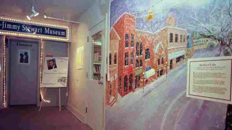 Lights circle the elevator entrance to the Jimmy Stewart Museum in Indiana, Pa., in 1999. The hall is decorated with movie posters, notes from movie studio executives, and this large mural depicting Bedford Falls, the mythical town in the film It's A Wonderful Life.