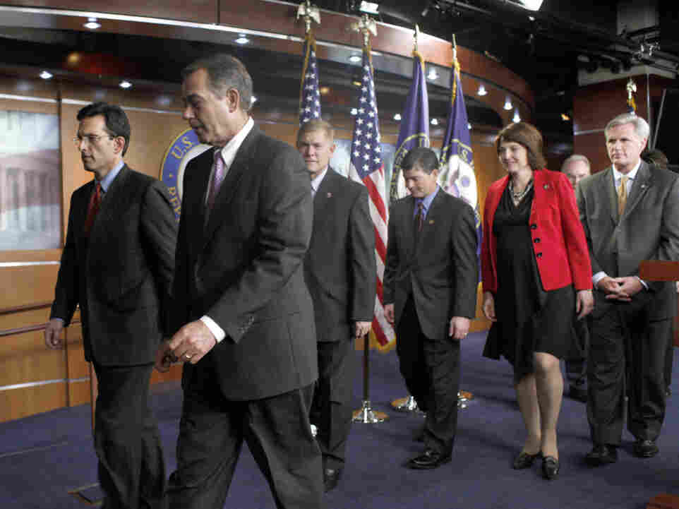 House Minority Whip Eric Cantor of Va., left, and House Speaker in waiting John Boehner of Ohio, second from left, with other top House Republicans.