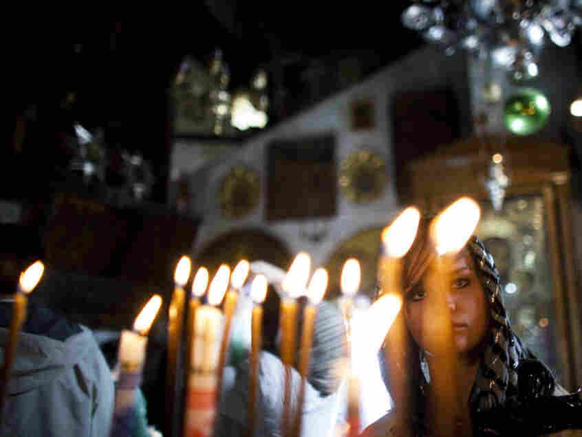 In Bethlehem today, pilgrims were lighting candles in the Church of the Nativity -- the sacred site believed to be the birthplace of Jesus.