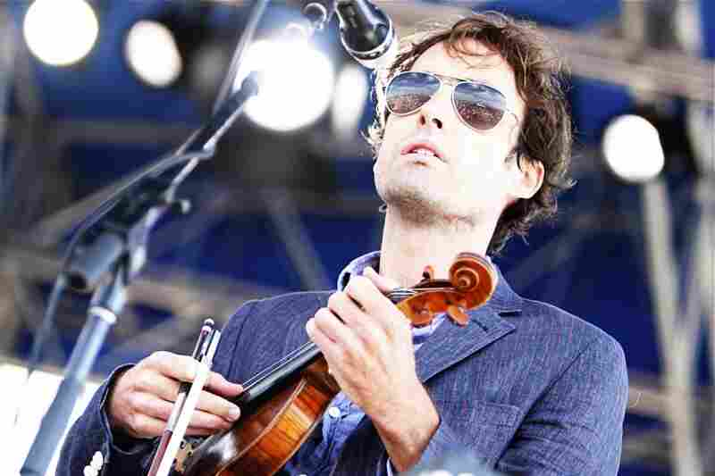 I love this shot of Andrew Bird at the Newport Folk Festival.  The look on his face, the color of the blues, and the awesome sky and crowd reflected in his glasses.  What a great performer.