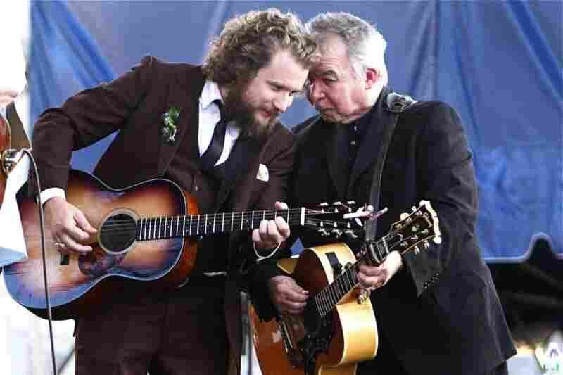 This was a great moment at Newport, when Jim James joined John Prine on stage towards the end of John Prine's set. Jim James used to listen to Prine's music as a kid with his parents on long drives. I love this photo because I want to know what they're talking about!