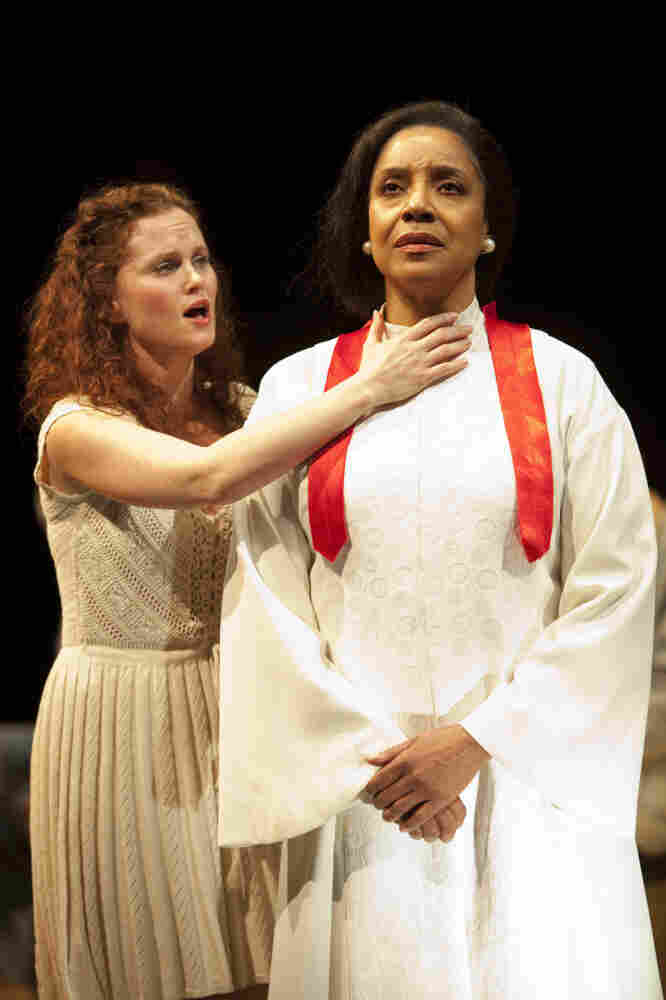 "In the new Washington, D.C., production at the Arena Stage called ""every tongue confess,"" Phylicia Rashad (right) plays a widowed preacher, mother and healer with a booming voice."