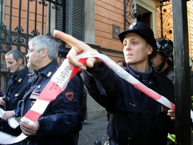 Police cordon off the Chilean Embassy in Rome, where a parcel bomb exploded today. A similar package exploded at the Swiss embassy.