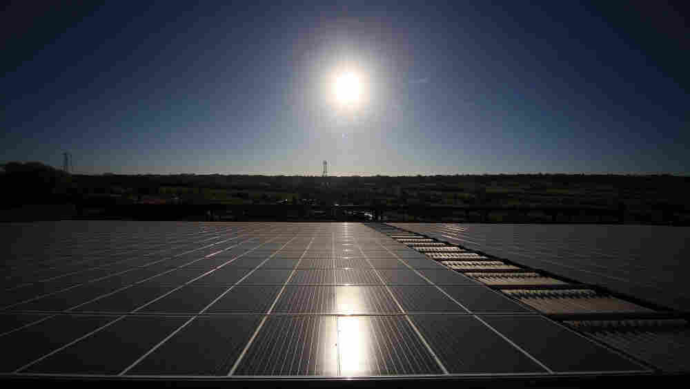 Solar panels like these in England turn energy from the sun into electricity. But researchers are looking to capture the sun's energy to make liquid fuels, by combining carbon dioxide, water and the chemical element cerium.