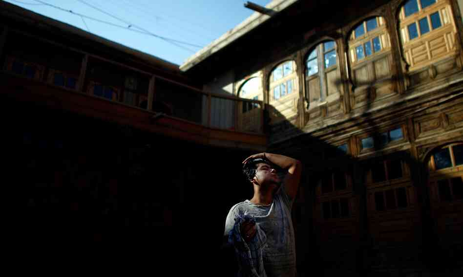 The Turquoise Mountain Foundation has been working for almost five years to restore Murad Khane, a quarter in Kabul's Old City. The area was built in the 18th century by Afghanistan's first ruler, Ahmad Shah Durrani. Here, an Afghan construction worker washes up before evening prayers.