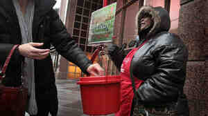 Antionette Levi solicits donations for the Salvation Army Dec. 21 in Chicago. As the season winds down, donations to Chicago area kettles have been over 10 percent shy of those received last year, but the organization hopes to match last year's record total of $139 million.