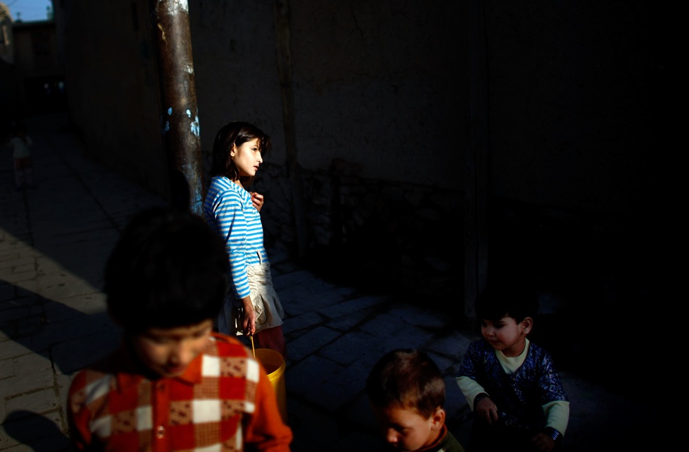 Afghan children are seen in an alley in Kabul's Old City. The buildings of Murad Khane were originally built to house members of the Afghan ruler's court and family.