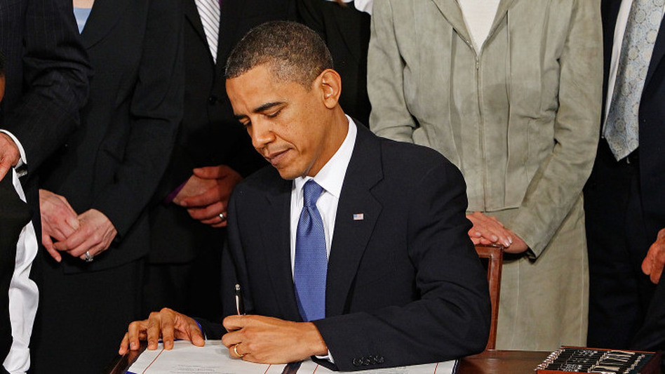 President Barack Obama signs the Affordable Health Care for America Act during a ceremony at the White House on March 23.