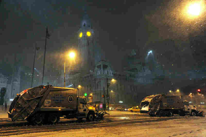 Snowplows clear the streets around City Hall in Philadelphia during the blizzard.