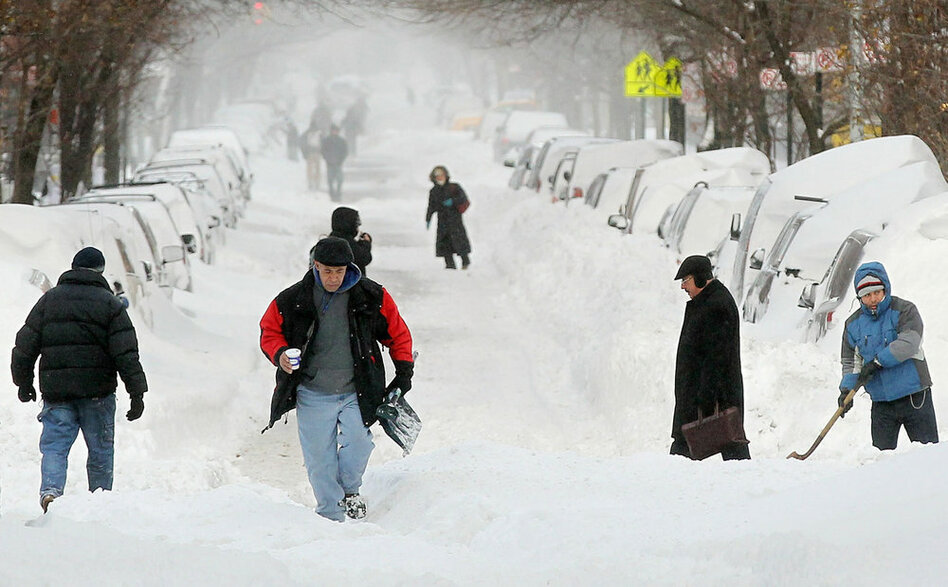 People walk through the snow in Manhattan's East Village in New York City. The tail end of a powerful storm across the Northeast snarled plans for millions of holiday travelers Monday, forcing airport closures and crippling road and rail traffic. The New York area was especially hard hit.  (Getty Images)