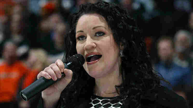 Canadian singer Holly Cole, seen here singing her country's national anthem, performed on Mountain Stage.