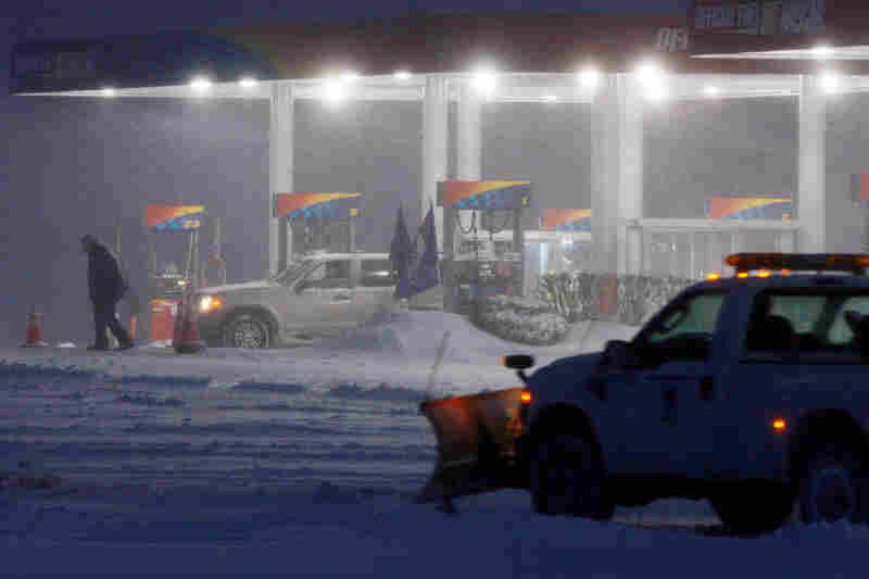 Snow blows at a rest area gas station on the Atlantic City Expressway near Hammonton, N.J.