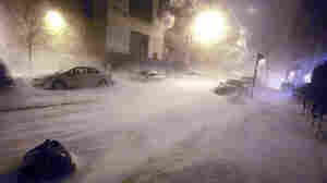 Snow falls in the early morning hours in Manhattan's East Village today (Dec. 27, 2010).