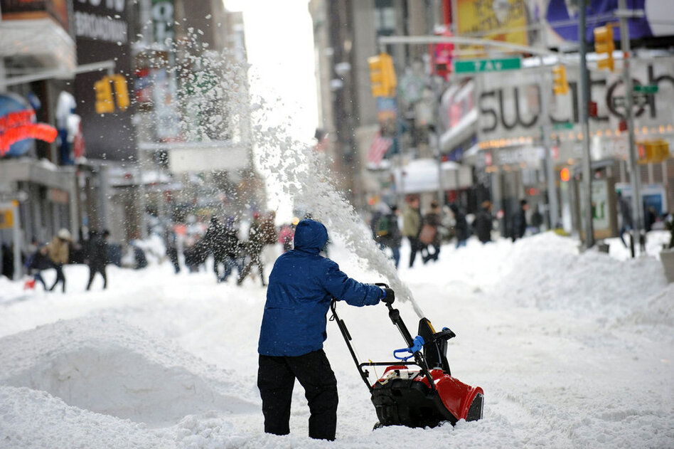 A man uses a snowblower to clear a street Monday in New York City's Times Square after a blizzard dropped 20 inches of snow in the area.  (AFP/Getty Images)