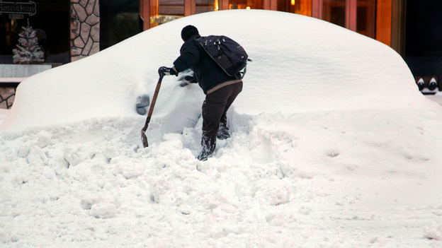 John Elliot of New York tries to dig out his rental car on a Manhattan street Monday, thanks in part to a good Samaritan who let him use a shovel, in the wake of the major snowstorm that is hammering New York and much of the Northeast. (AP)
