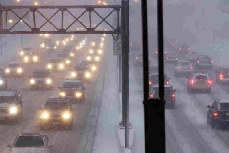 Cars creep along the Long Island Expressway during the blizzard in New York.