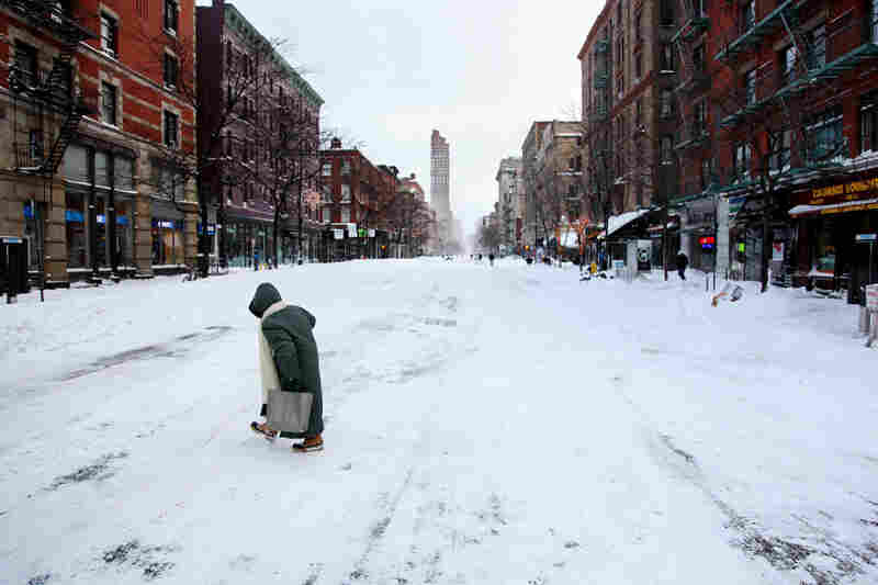 A pedestrian crosses a deserted Columbus Avenue in New York City.