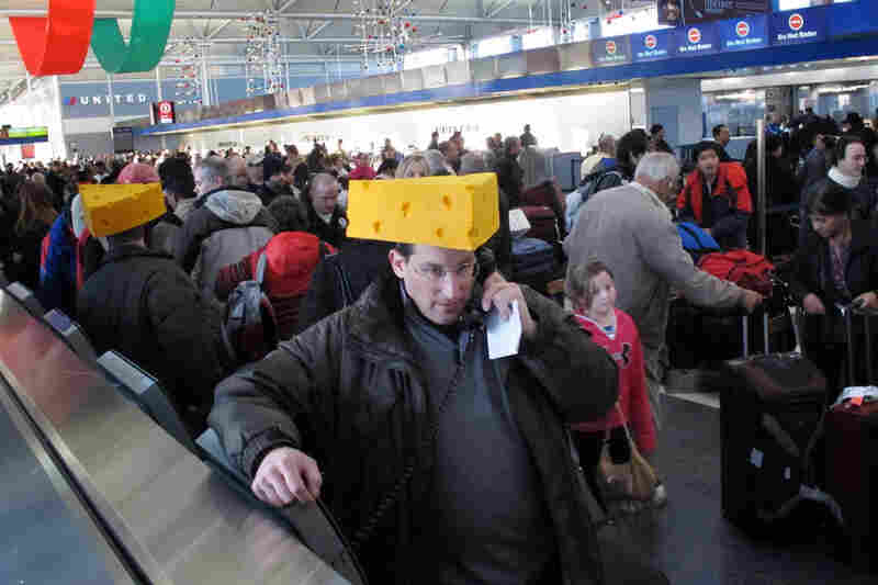 Doug Sherman of New York tries to rebook his flight home as long lines of travelers are stranded at Chicago's O'Hare International Airport because of many flight cancellations. Sherman had attended Sunday's NFL football game between the New York Giants and the Green Bay Packers.