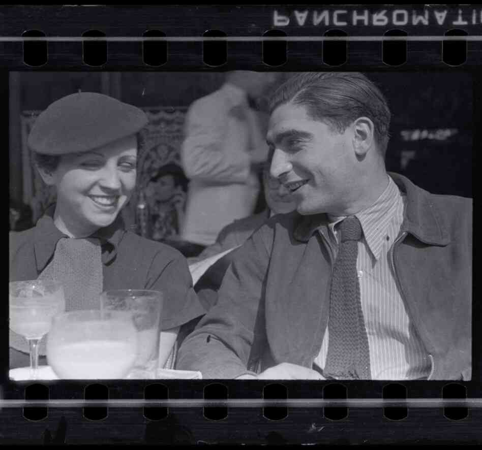 Gerda Taro and Robert Capa on the terrace of Cafe du Dome in Montparnasse, Paris, early 1936