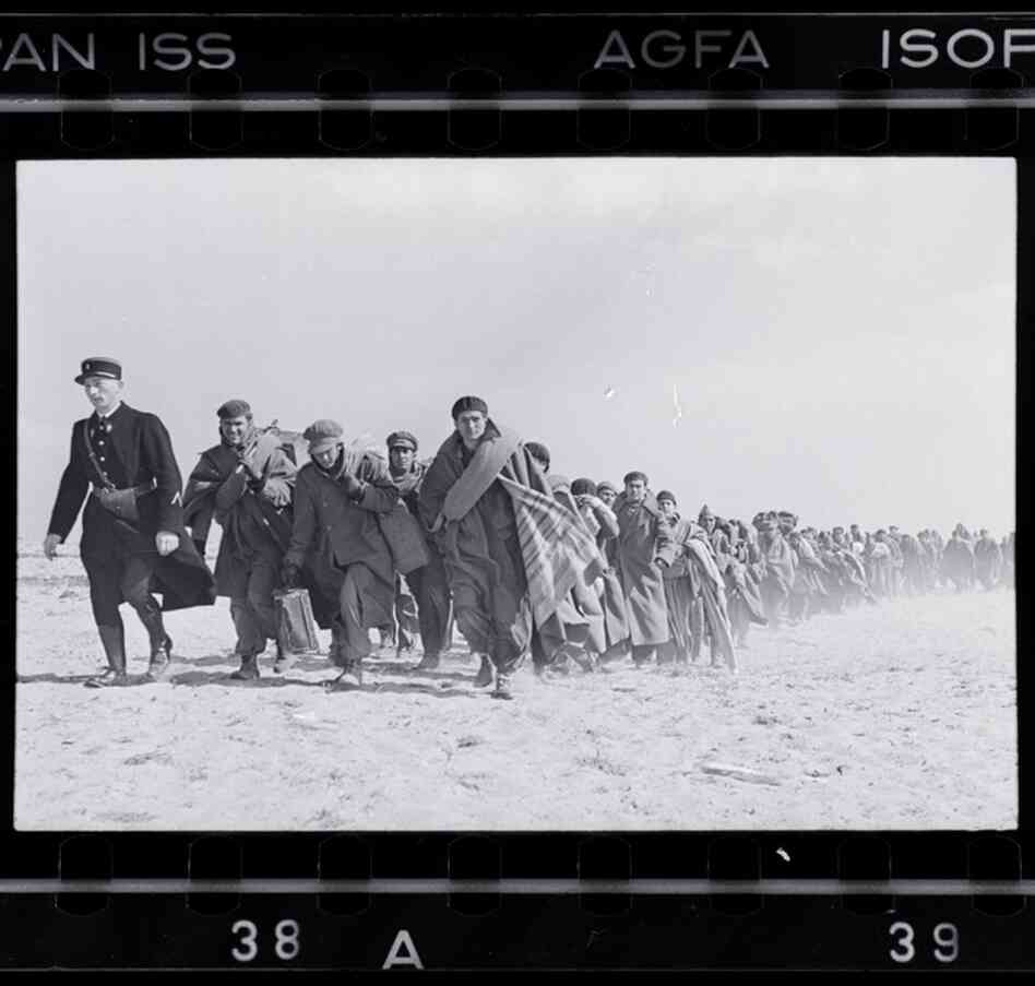 Exiled Republicans being marched down the beach to an internment camp, Le Barcares, Fr
