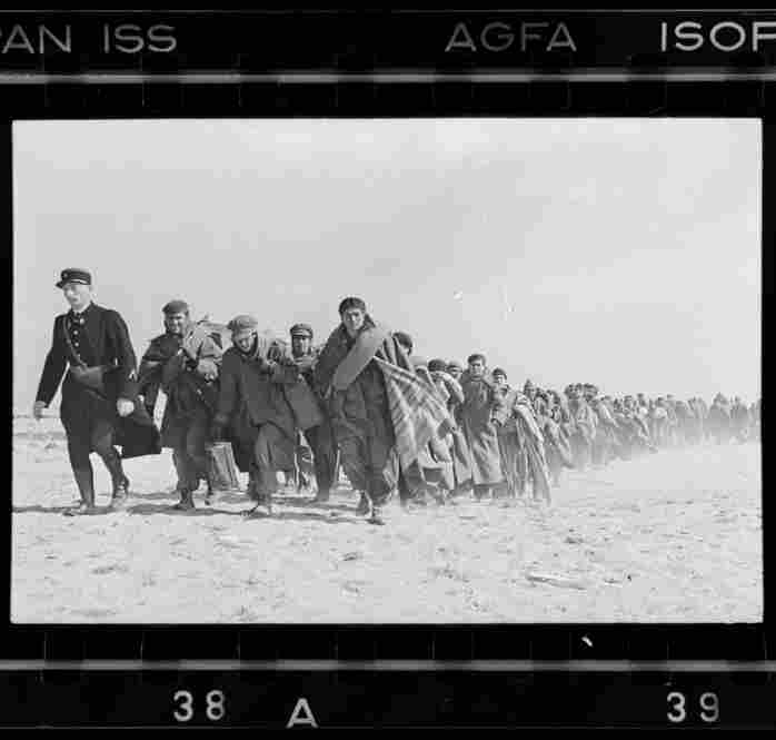 Exiled Republicans being marched down the beach to an internment camp, Le Barcares, France, March 1939