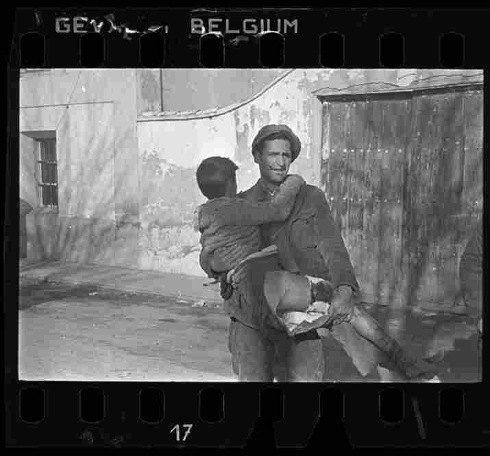 Man carrying a wounded boy, Teruel, Spain, late Dec. 1937