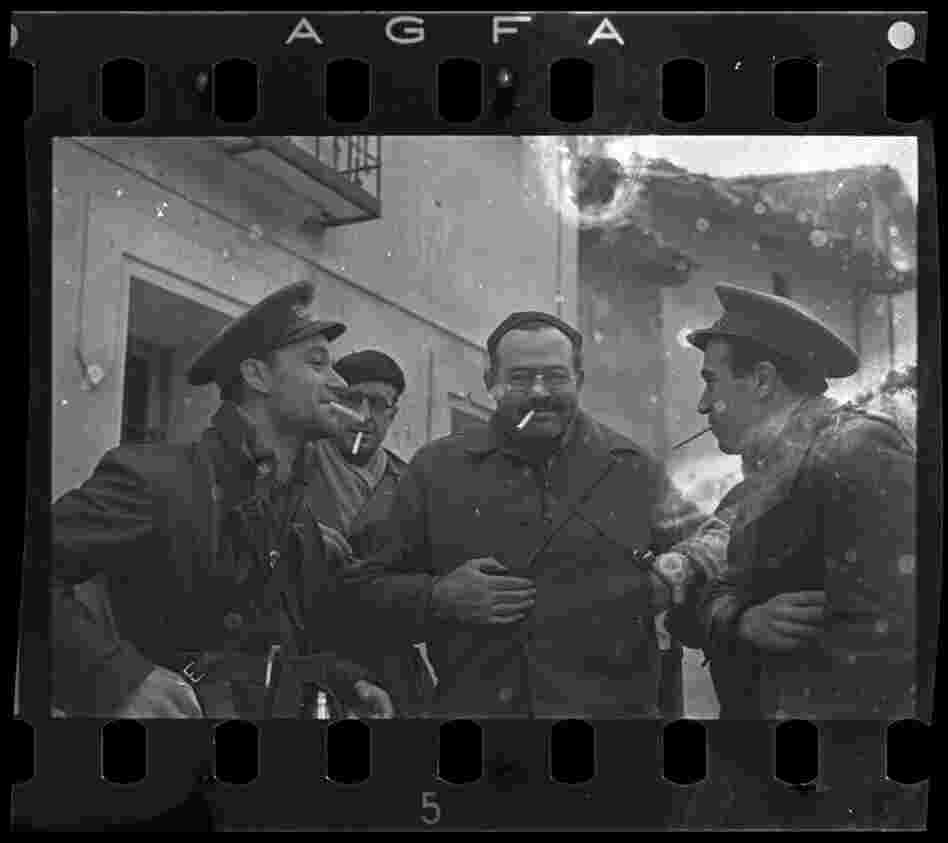 Ernest Hemingway (third from the left), New York Times journalist Herbert Matthews (second from the left) and two Republican soldiers, Teruel, Spain, late Dec. 1937