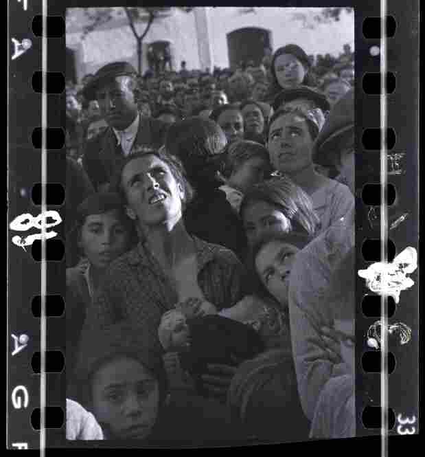 Mother nursing a baby while listening to political speech, near Badajoz, Extremadura, Spain, late April - early May 1936 )