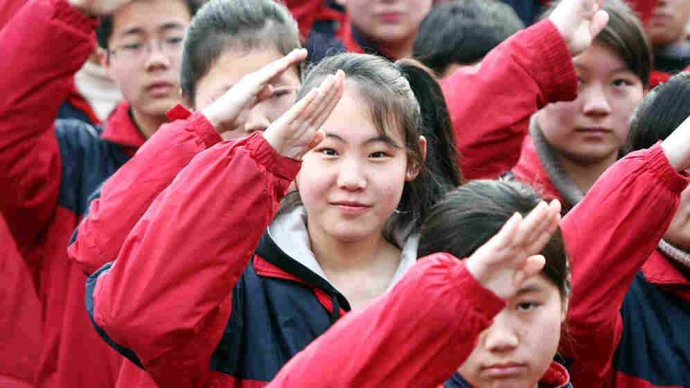 Chinese students salute during a flag-raising ceremony at a junior high school in Shanghai, China, Feb. 22, 2010. For the first time, Chinese students participated in international standardized testing -- and came out on top.