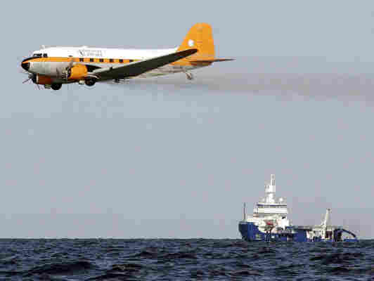 Plane dropping dispersants over the Gulf oil spill