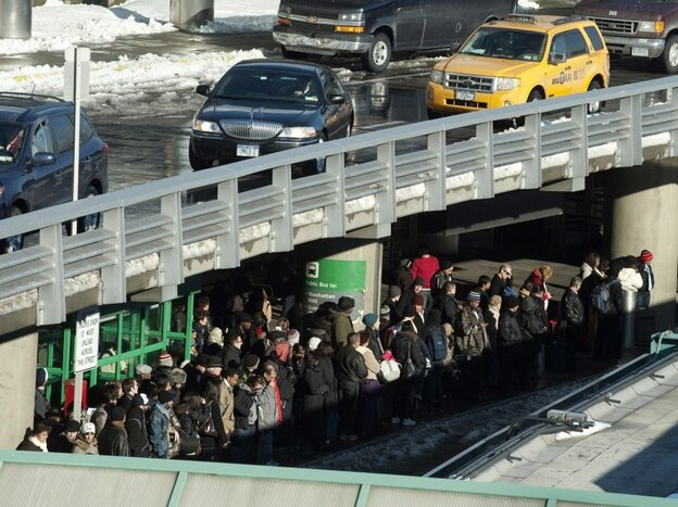 Travelers wait for taxis from New York's LaGuardia Airport on December 28, 2010.