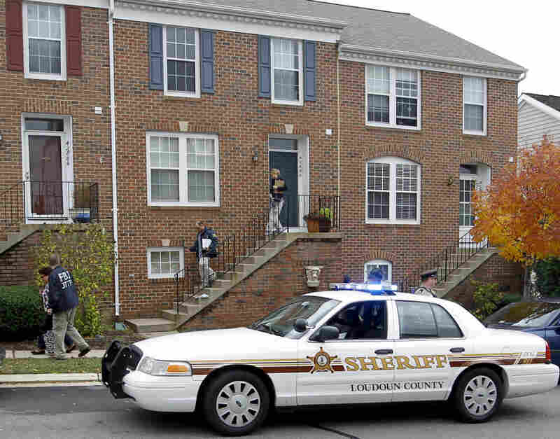 FBI and law enforcement investigators leave the home of Farooque Ahmed in Ashburn,  Va., on Oct. 27. Ahmed was charged with trying to help people he believed were al-Qaida operatives plan to bomb subway stations around Washington,  D.C.