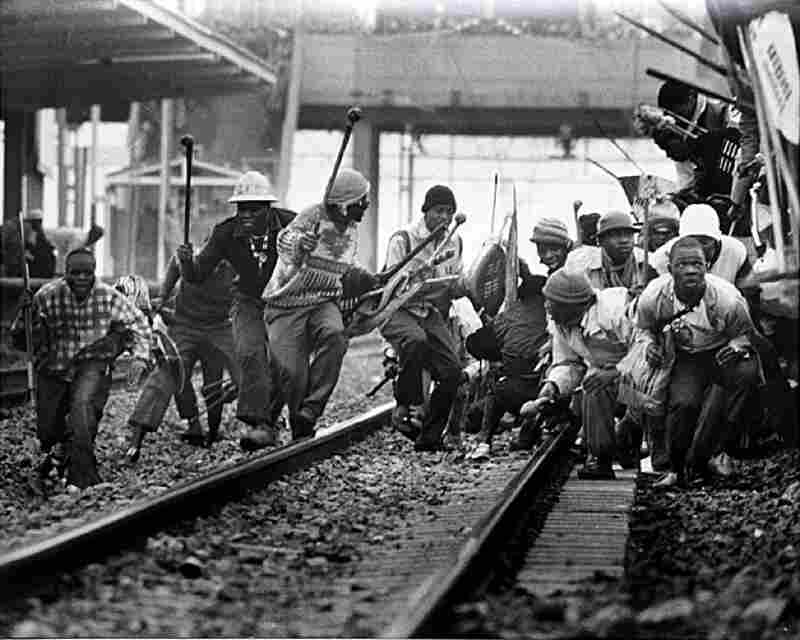 Zulu Inakatha Freedom Party members evacuate a train after a rally, South Africa, 1990s. In 2000, Silva co-authored The Bang-Bang Club with Greg Marinovich, an account of the press photographers who covered the end of the apartheid era in South Africa.