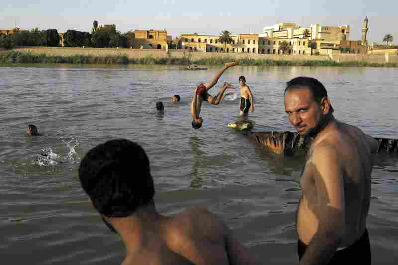 Baghdad residents swim and bathe in the Tigris River, 2004.
