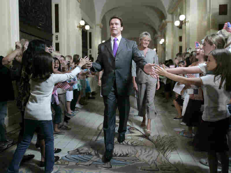 Gov. Arnold Schwarzenegger is greeted by children as he walks to a ceremony to honor Olympic athletes from California at the state Capitol in 2008. Despite his ability to draw a crowd, Schwarzenegger leaves office on a low note, with an approval rating of just 23 percent.