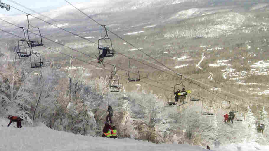 This photo provided by Betsy Twombly shows a skier being helped down from a lift chair, center, after a lift derailed on the state's tallest ski mountain at the Sugarloaf resort in Carrabassett Valley, Maine, Tuesday, Dec. 28, 2010.