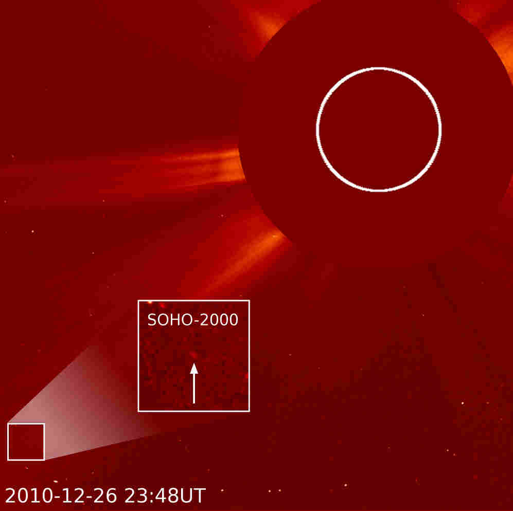 This image, taken from the SOHO spacecraft, shows the sun and surrounding outer space, with a comet highlighted.