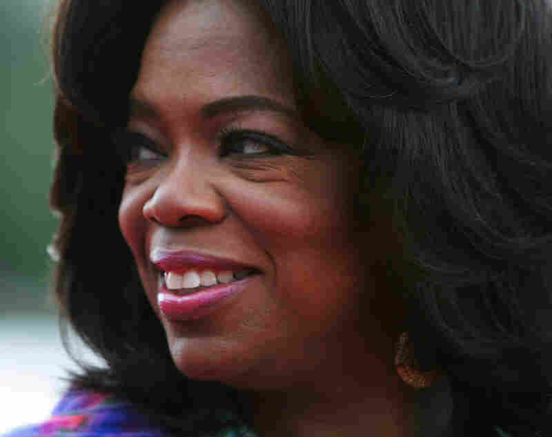 Oprah Winfrey arrives at Sydney's Royal Botanic Gardens for a garden party on Dec. 11
